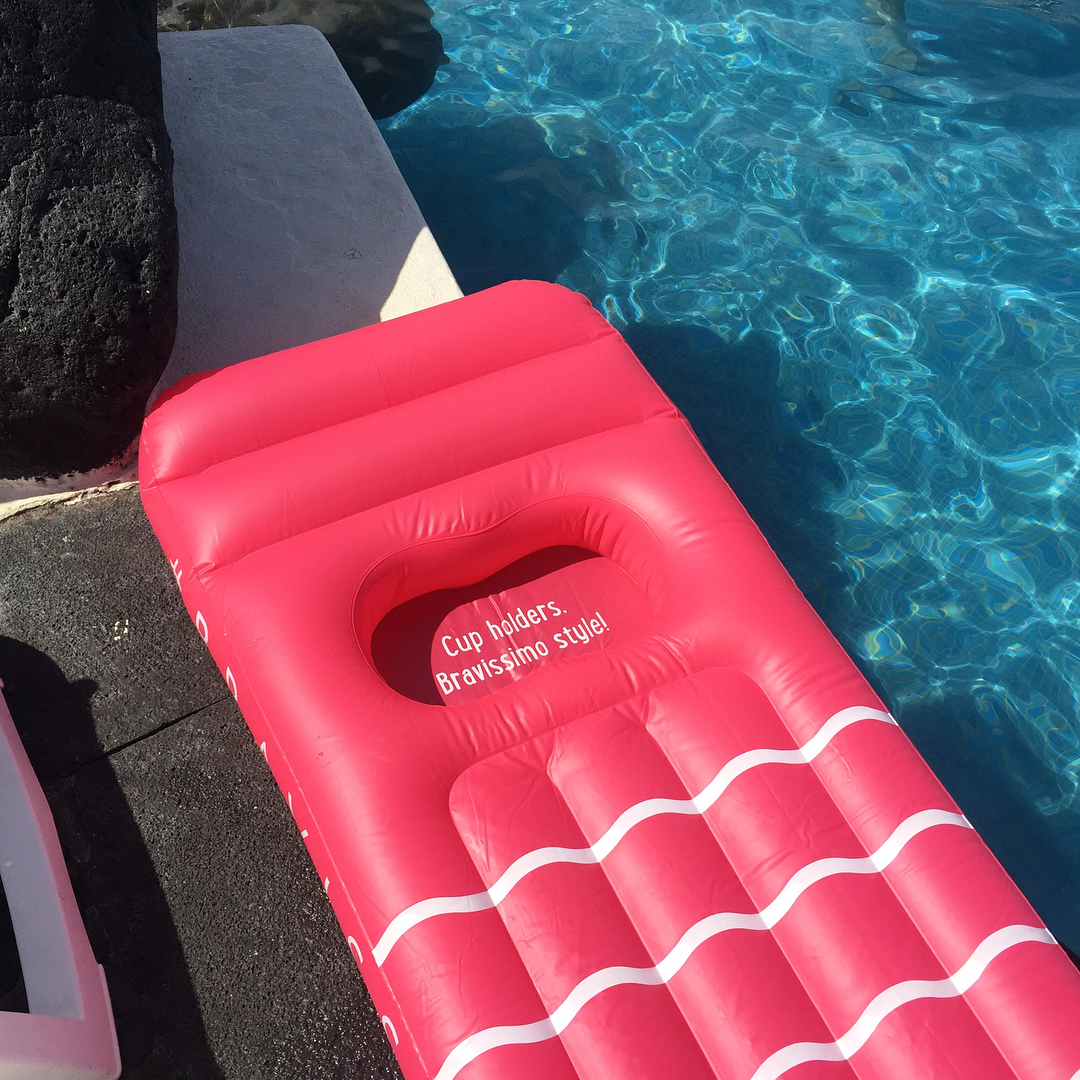 pink pool float sitting beside pool