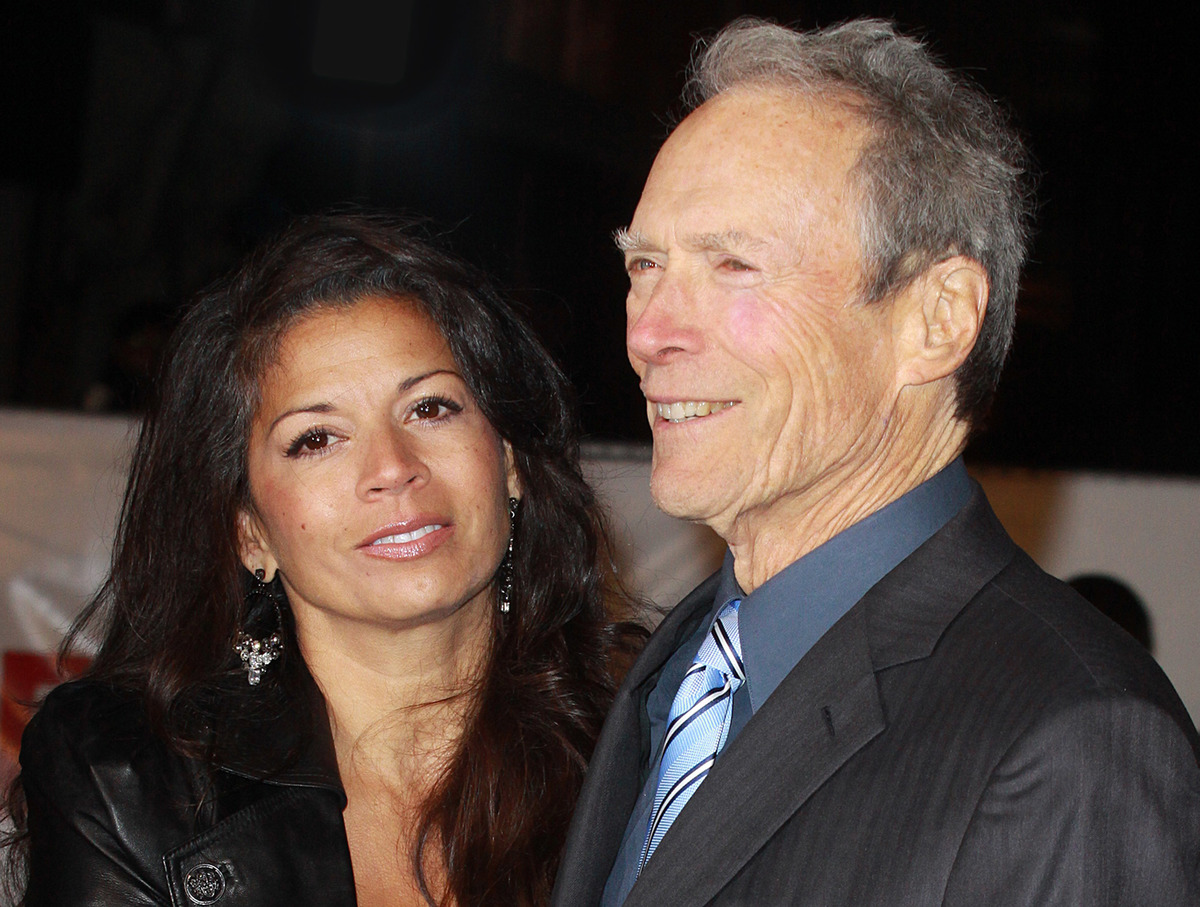 Clint Eastwood and wife Dina Ruiz attends the UK Film Premiere of 'Invictus' at Odeon West End on January 31, 2010 in London, England.