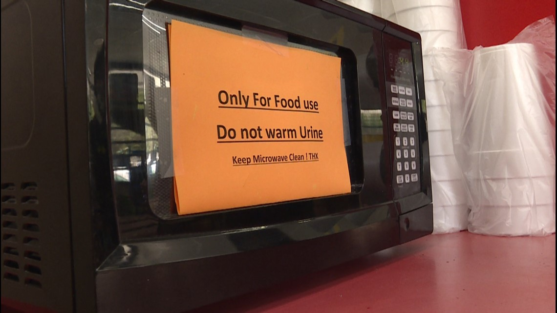 sign on a microwave that warns people not to warm anything other than food