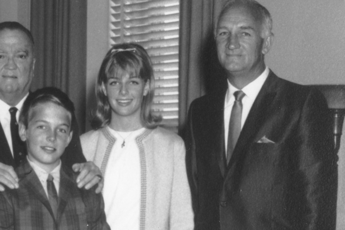 j edgar hoover puts his hands on the shoulders of mark harmon, here with his older sister kelly and father tom harmon
