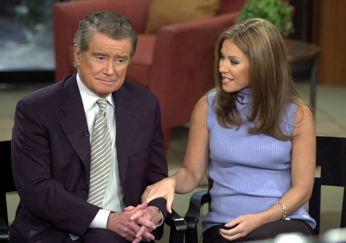 Talk show host Regis Philbin and new co-host Kelly Ripa speak to the audience during a broadcast of