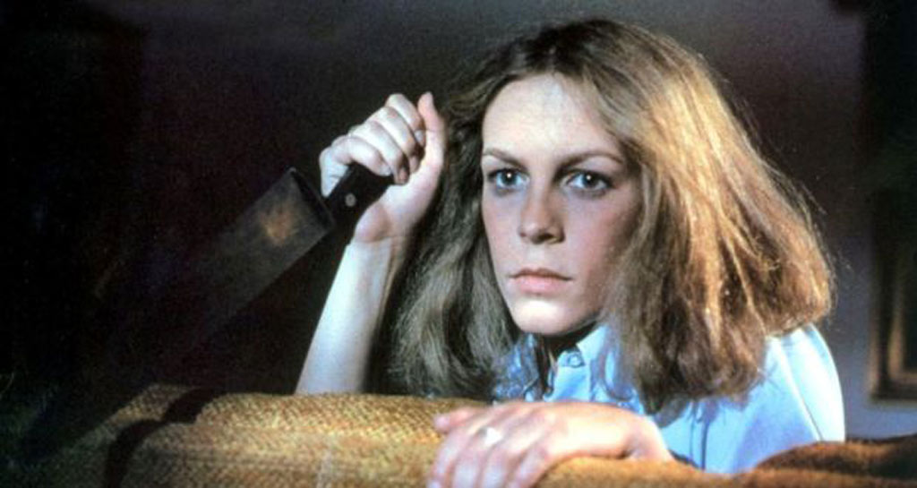 Jamie Lee Curtis holds a knife in Halloween