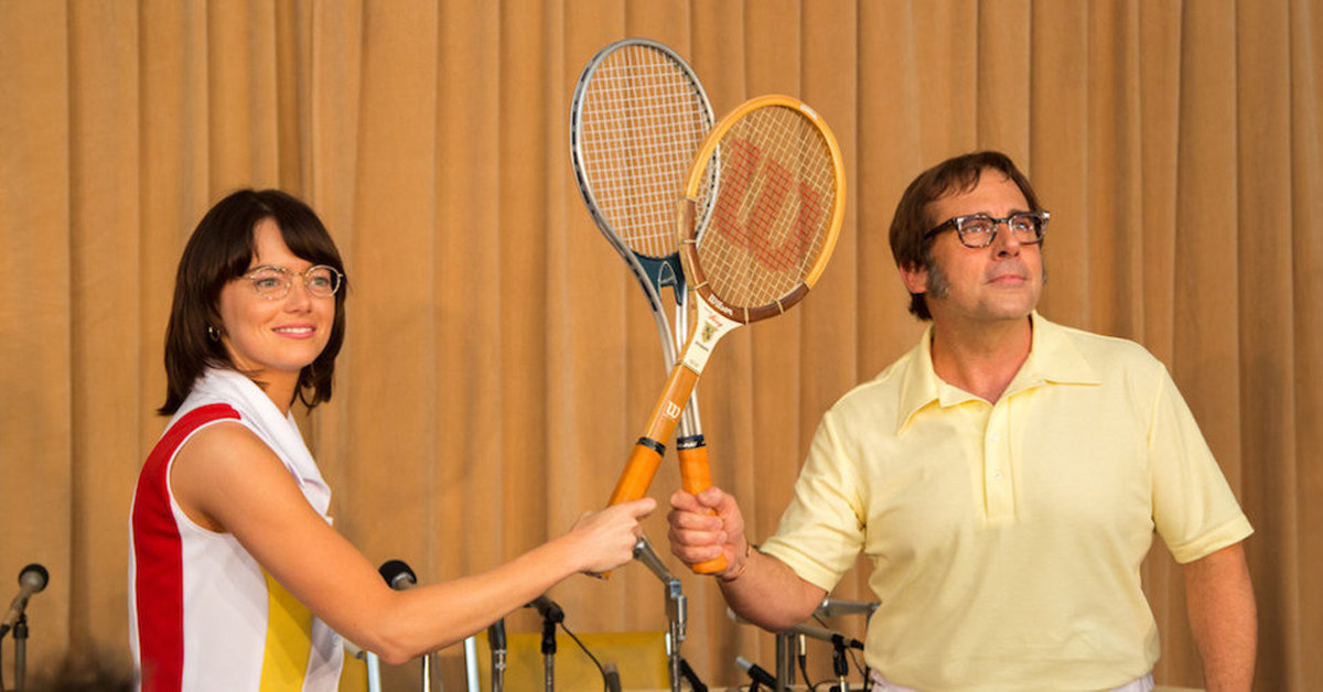 emma stone and steve carell holding tennis rackets