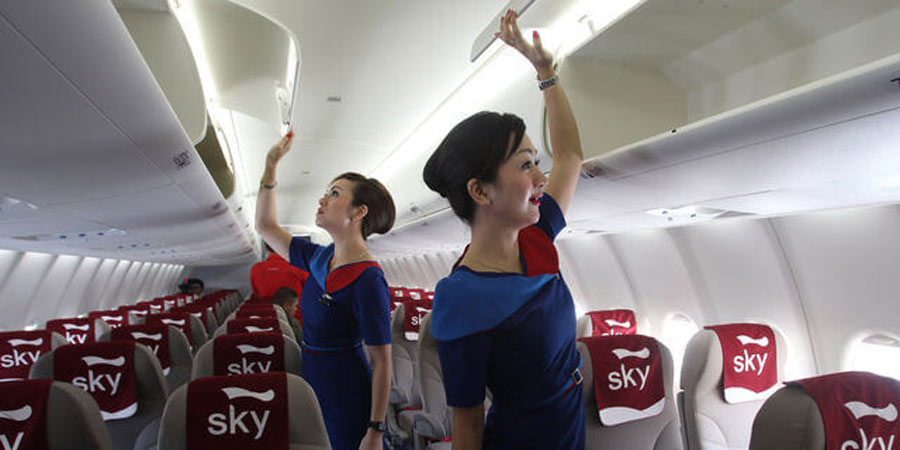 Flight attendants checking cabins