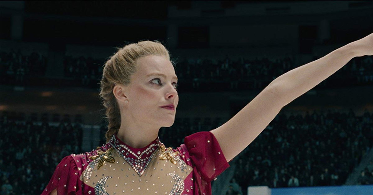 margot robbie striking a pose ice skating as tonya harding