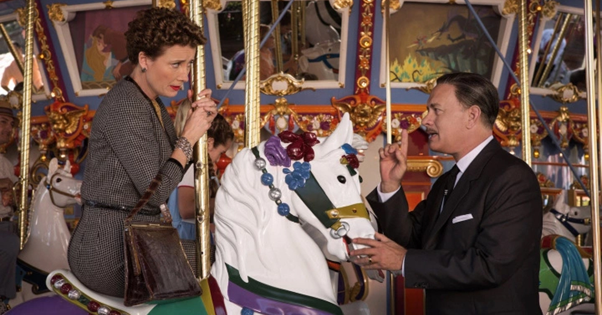 emma thompson on a disneyland carousel horse with tom hanks