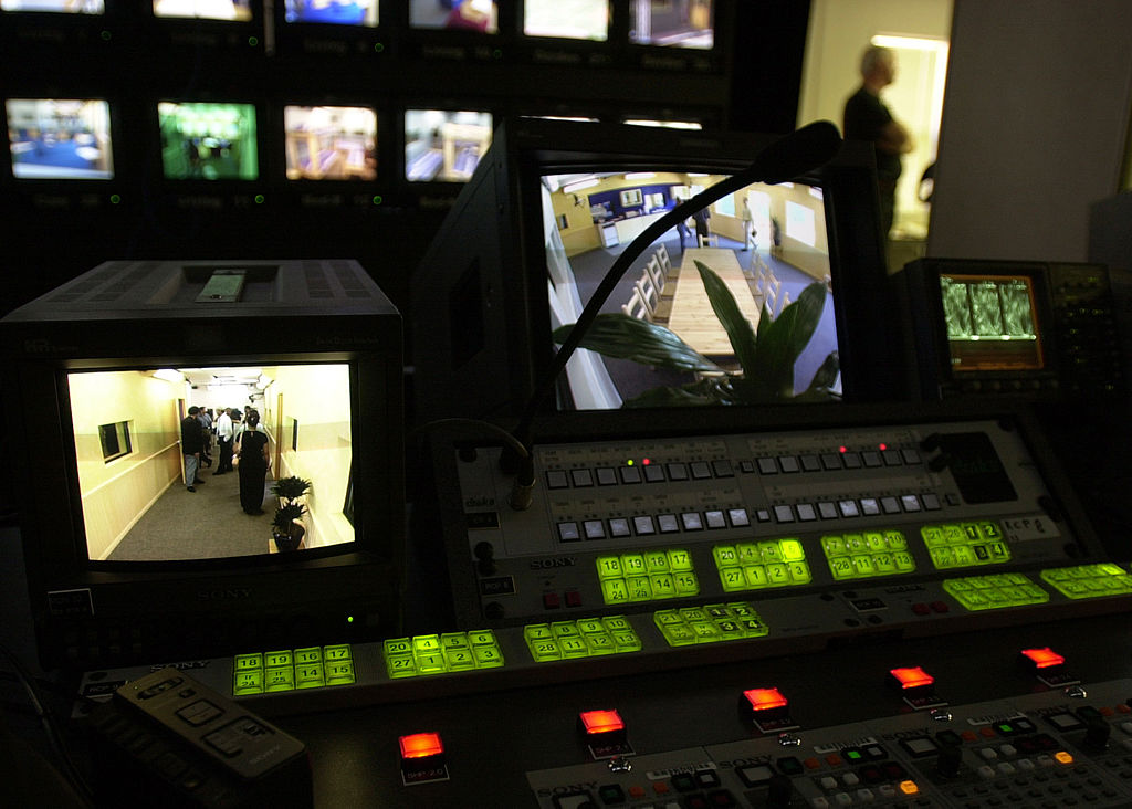 A control room with numerous monitors are set up for the new reality-based show