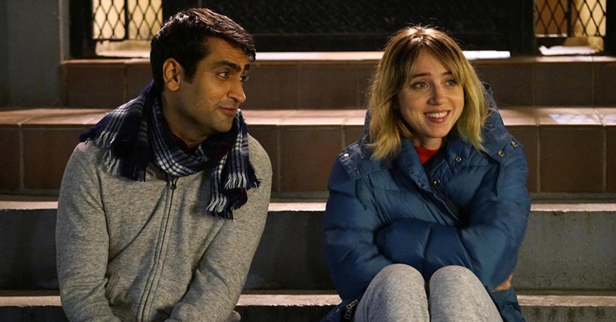 kumail nanjiani and zoe kazan talking and sitting on steps