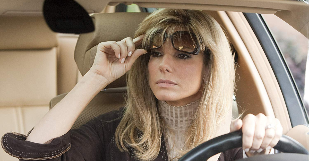 sandra bullock lifting her sunglasses while driving in the blind side