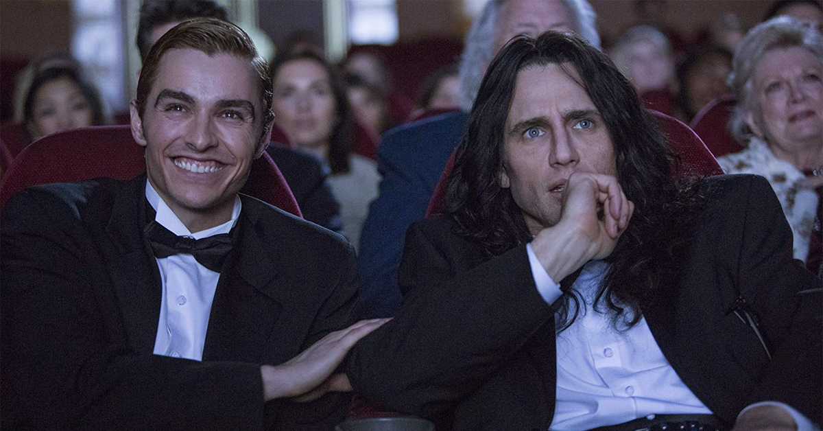 dave and james franco watching a movie screen