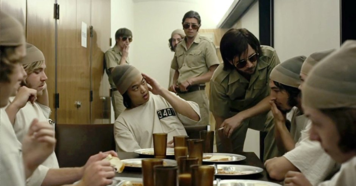 cast of the stanford prison experiment eating at a table