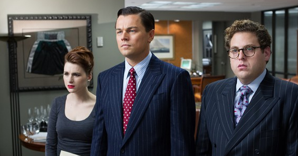 aya cash, leonardo dicaprio, and jonah hill on the set of the wolf of wall street