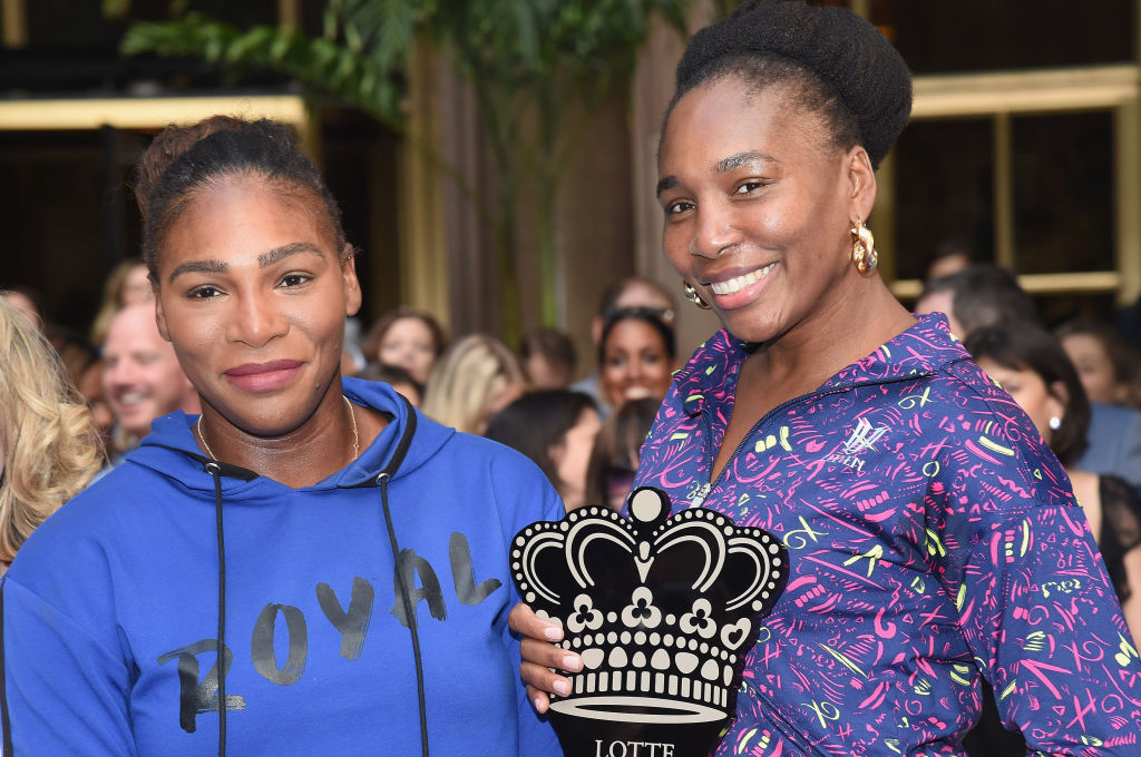 GettyImages-1022049950 Serena Williams and Venus Williams pose during the 2018 Palace Invitational Badminton Tournament