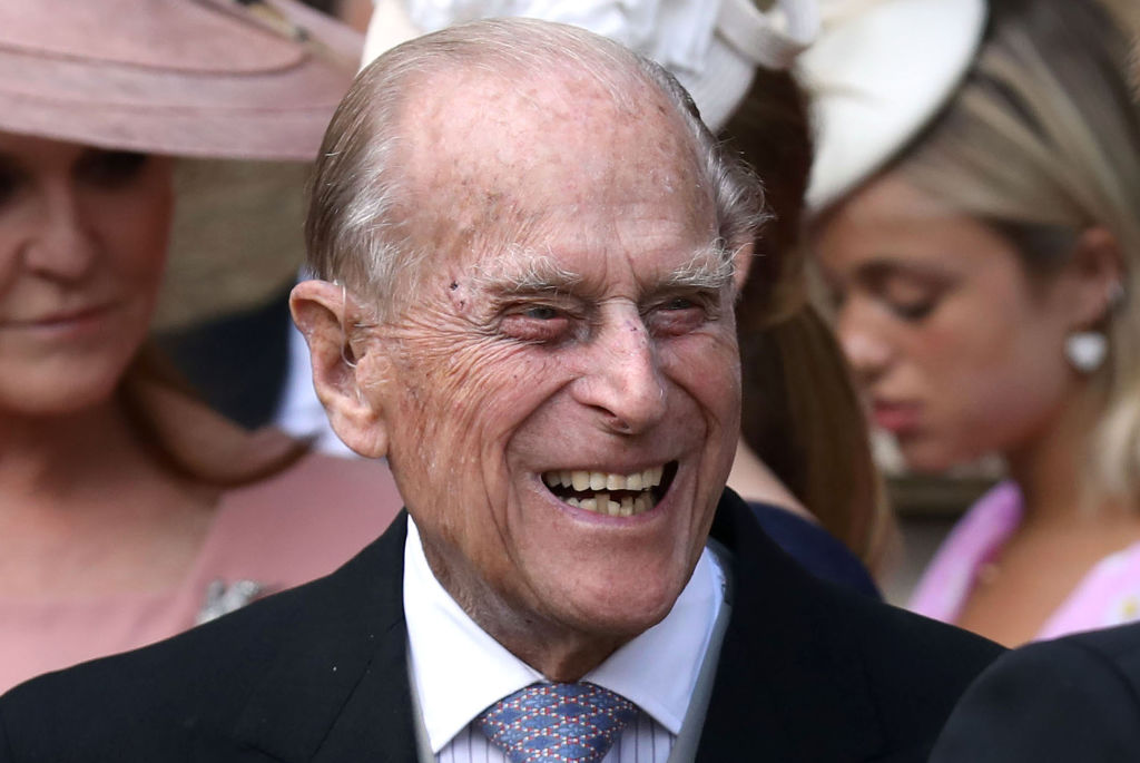 GettyImages-1144650679 Britain's Prince Philip, Duke of Edinburgh reacts as he talks with Britain's Prince Harry, Duke of Sussex as they leave St George's Chapel in Windsor Castle