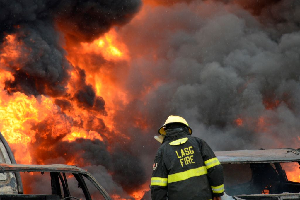 GettyImages-1153780092 Fire fighters try to put out rages on at Ijegun, Lagos, Nigeria
