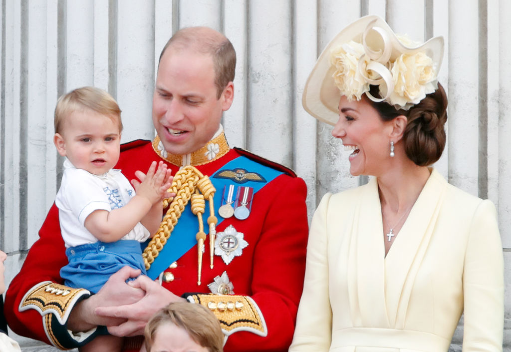 GettyImages-1154678346 Prince William, Duke of Cambridge, Catherine, Duchess of Cambridge and Prince Louis of Cambridge stand on the balcony of Buckingham Palace during Trooping The Colour, the Queen's annual birthday parade, on June 8, 2019 in London, England.