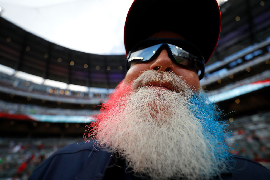 GettyImages-1160115925 Grounds crew assistant Mike Bradberry shows off his beard as he celebrates the Fourth of July