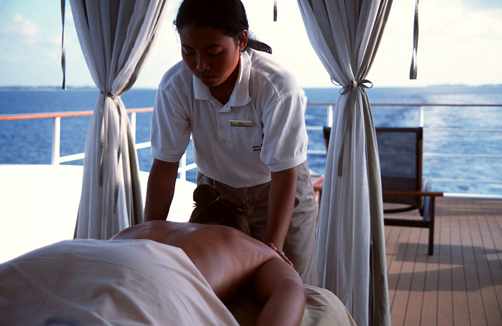 A massage onboard the Four Season's Explorer. The Explorer is a luxury upmarket catamaran that cruises the Maldivian archipelago, an all island country off the coast of southern India-461711880