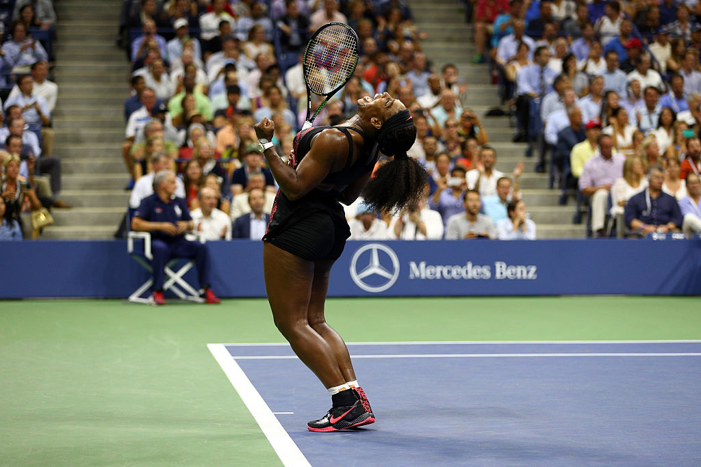 GettyImages-487322044 Serena Williams of the United States celebrates after defeating Venus Williams