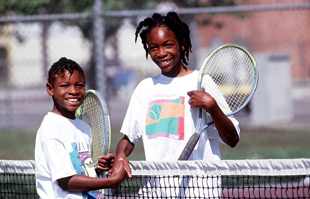 GettyImages-666551 Sisters Serena, left, and Venus Williams shake hands after a game 1991 in Compton, CA.
