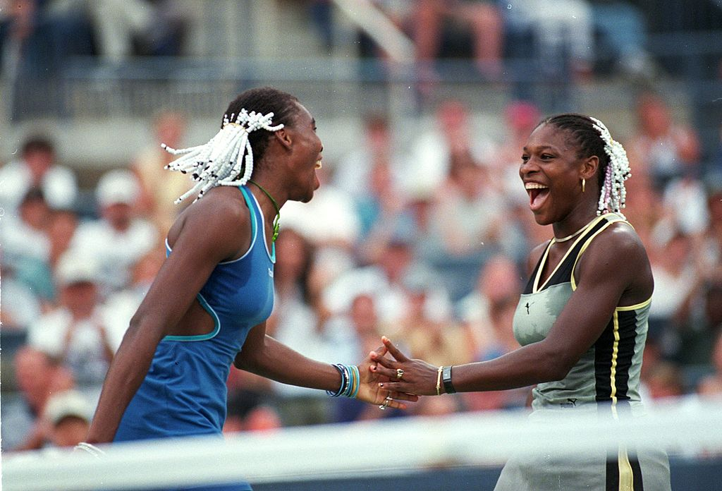 GettyImages-72543797 9 Sep 1999: Venus Williams(l) and Serena Williams(r) of the USA celebrate after the doubles match