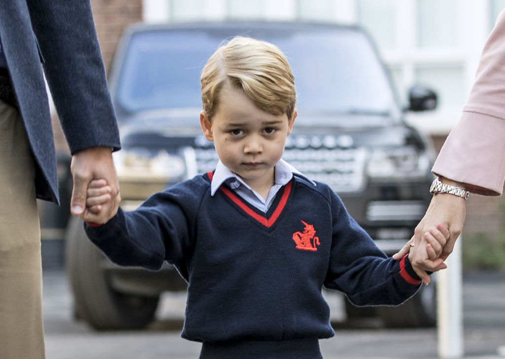 GettyImages-843667722 prince george accompanied by Britain's Prince William (L), Duke of Cambridge arrives for his first day of school at Thomas's school
