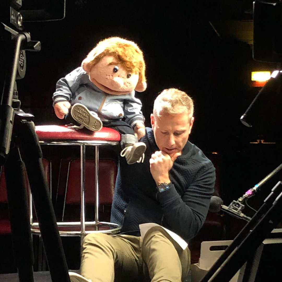paul zerdin with puppet reading a script