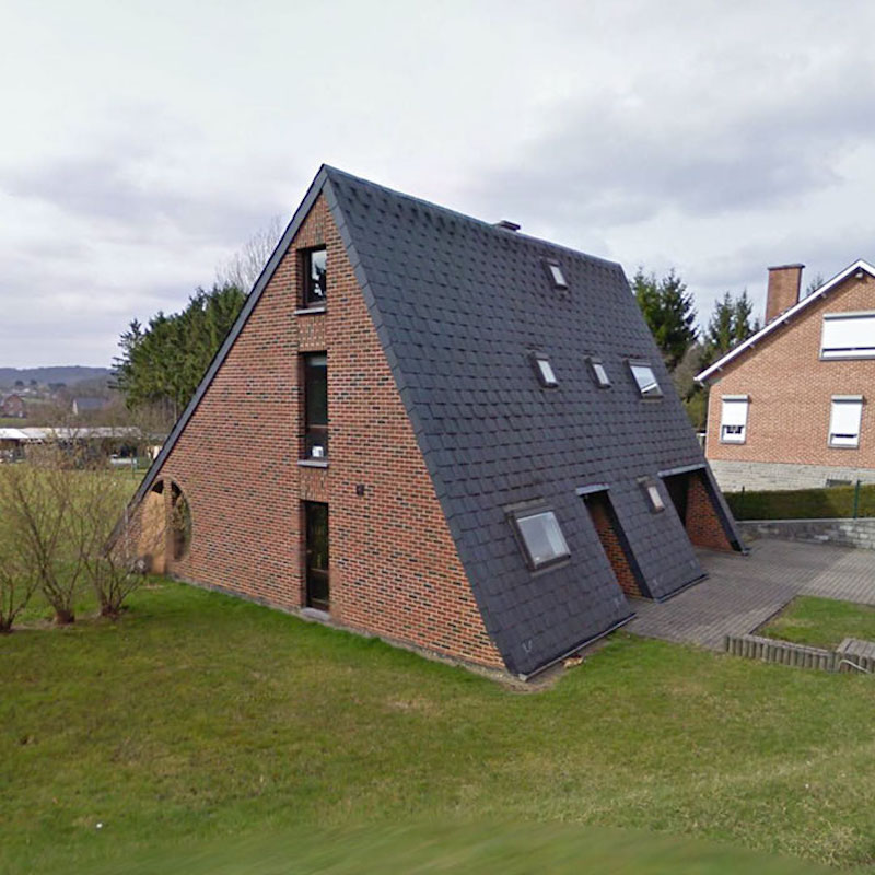 triangular sloped house that looks like it's all roof