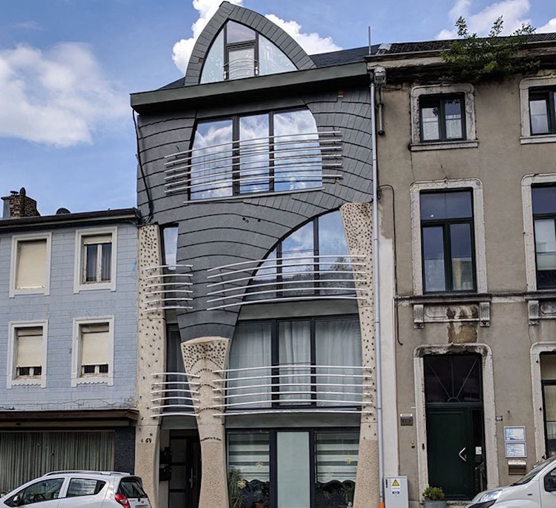 wonky house with railings curved apartment building