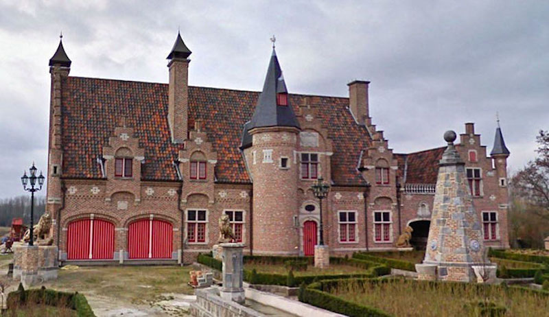 this red and black brick house looks like a castle