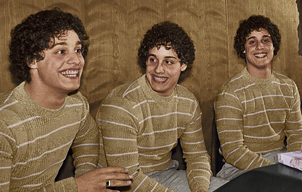 Three brothers in striped shirts