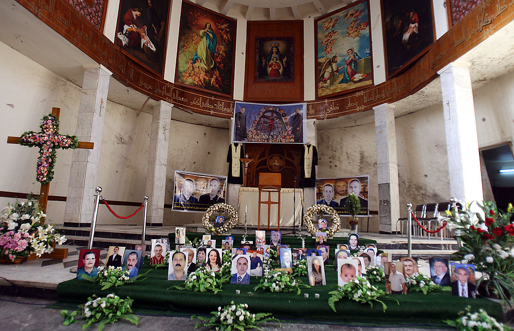 Photographs of victims are showcased on the church's alter.