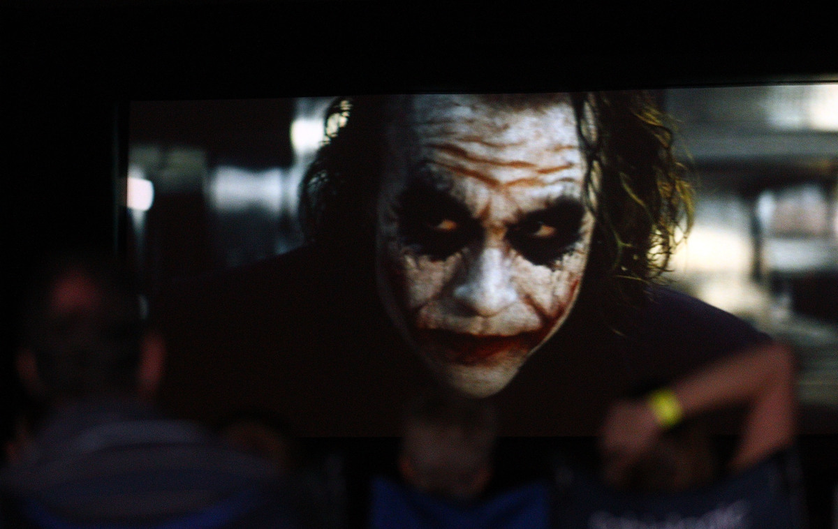 The Dark KNight on screen with heath ledger as the joker