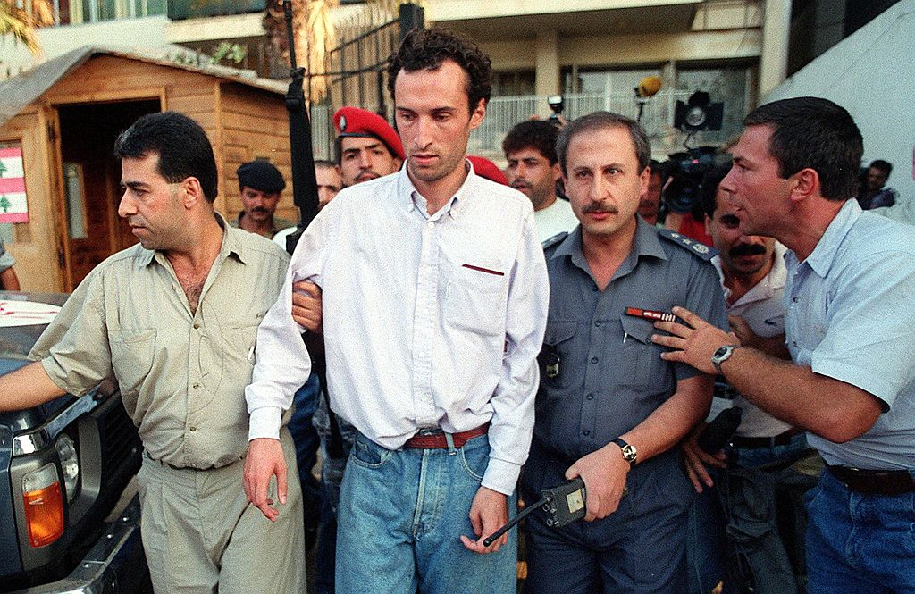 Frenchman Jerome Leyraud is crowded by onlookers as he is freed by Lebanese security.