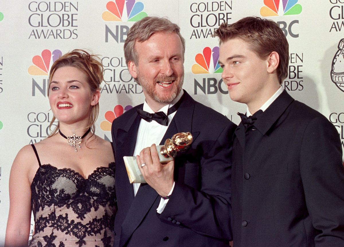 Winslet, Cameron, and DiCaprio at Golden Globes after Cameron wins for best director