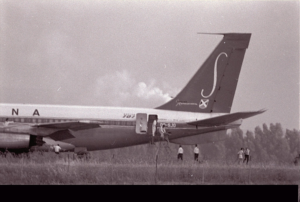 Passengers are escorted off of flight 571 once the landed plane has become secured.