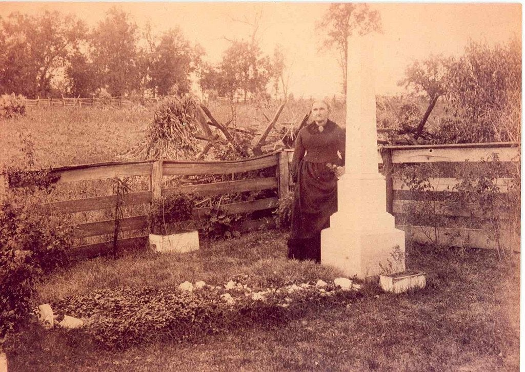 Mother of Jesse James at her outlaw son's grave site, date unknown