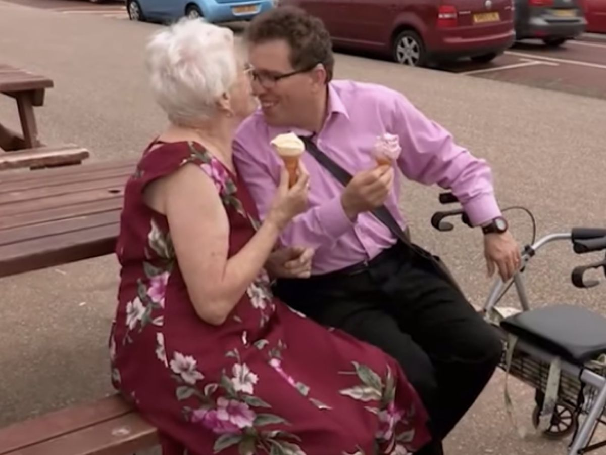 couple cuddling on park bench with icecream