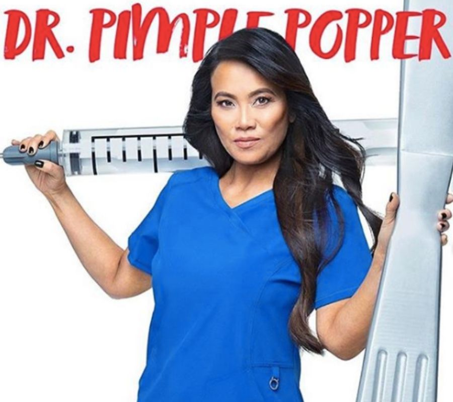 dr pimple popper standing looking incredible