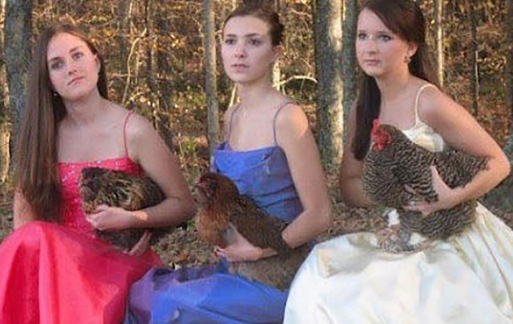 Girls holding chickens