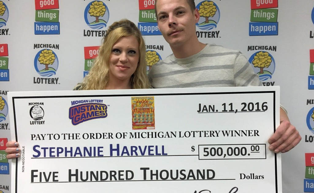 Couple holding big check