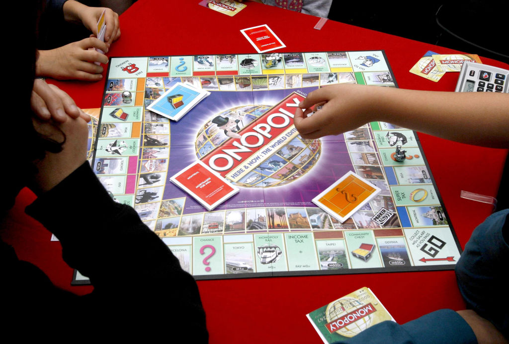 Monopoly enthusiasts play the first-ever international Monopoly edition game board