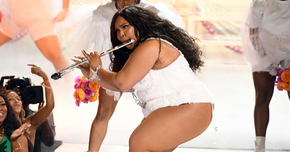 Lizzo plays the flute onstage at the 2019 BET Awards