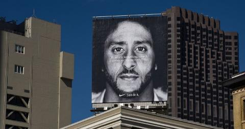 A billboard featuring Colin Kaepernick mounted on top of a building in Union Square in San Francisco,