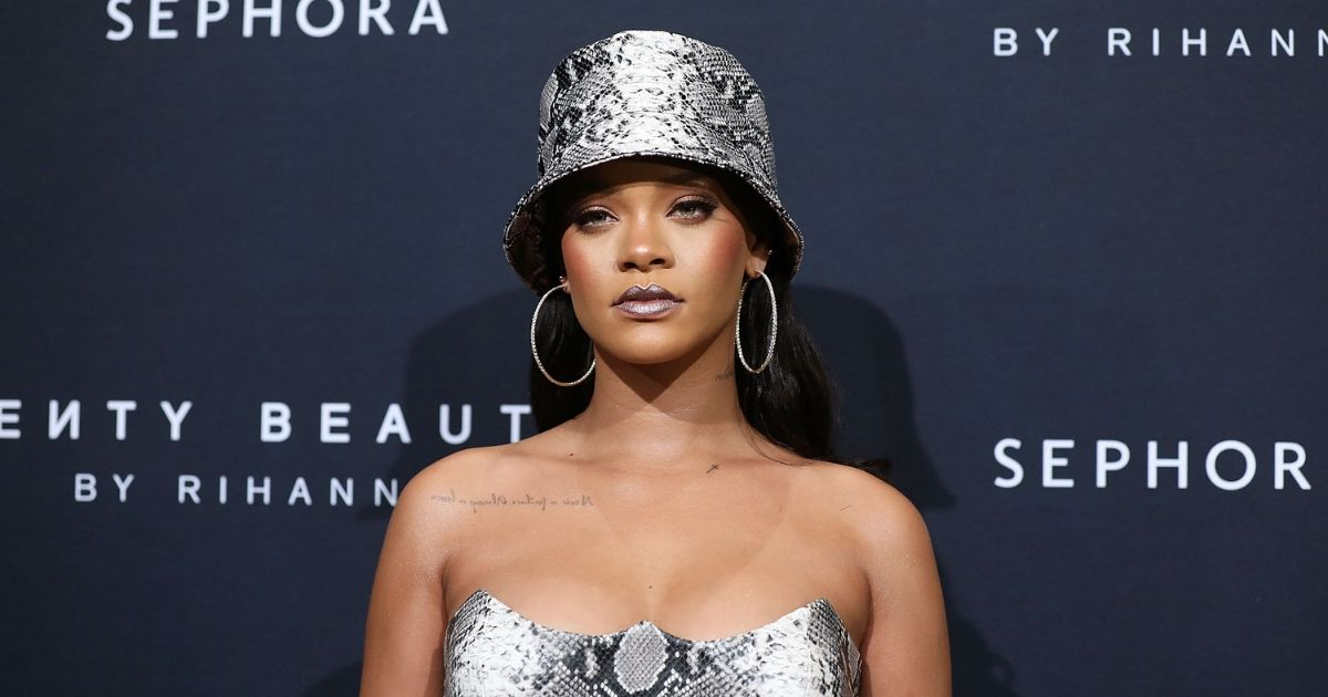 Rihanna attends a red carpet event for Fenty Beauty