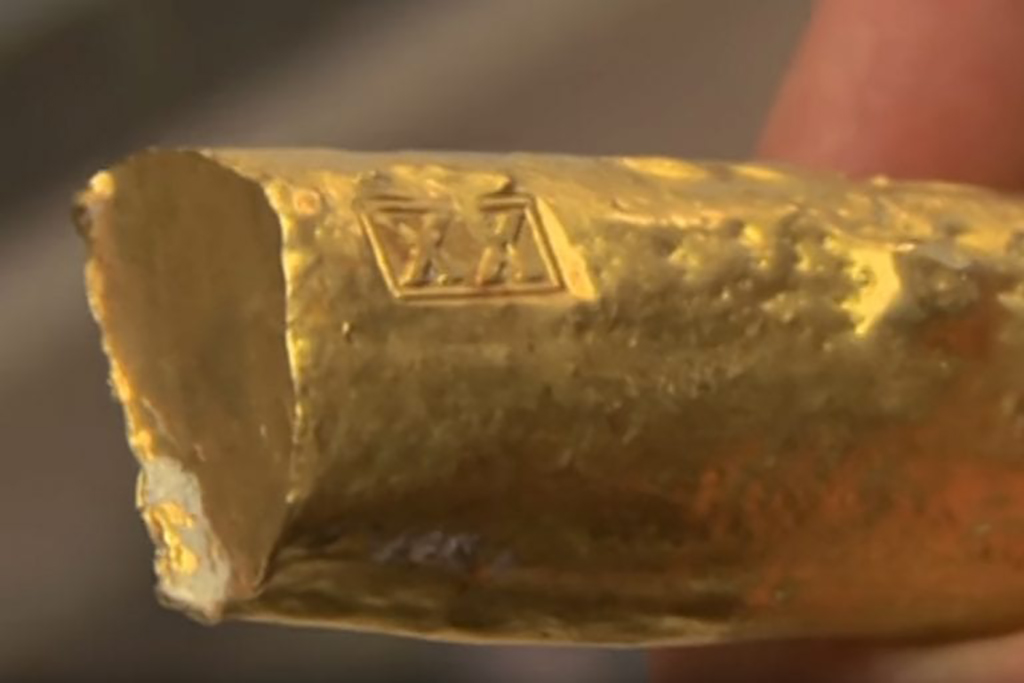 Gold bar with x's
