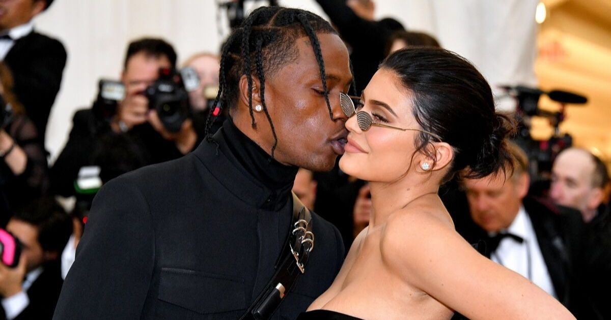 Travis Scott kisses Kylie Jenner on the cheek at the 2018 Met Gala