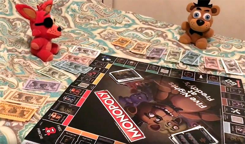 Stuffed animal characters from the show Five Nights at Freddy's are pictured around the Monopoly game version based on the show