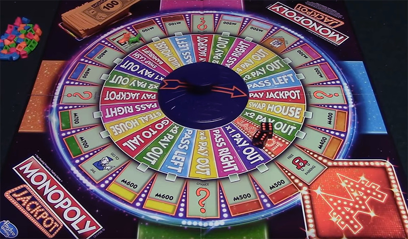 The Monopoly Jackpot game appears like a wheel with a spinner in the middle