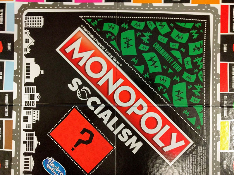 A photo shows the Monopoly Socialism gameboard from above